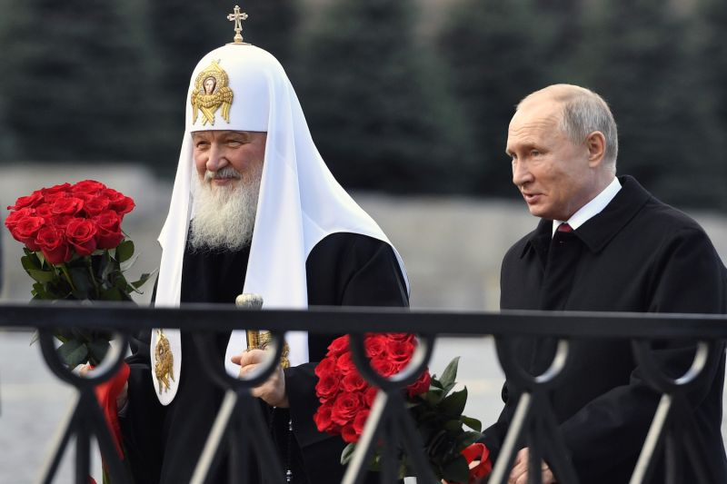 Russian President Vladimir Putin and Patriarch of Russia Kirill lay flowers at a monument in Moscow's Red Square on Nov. 4, 2018.