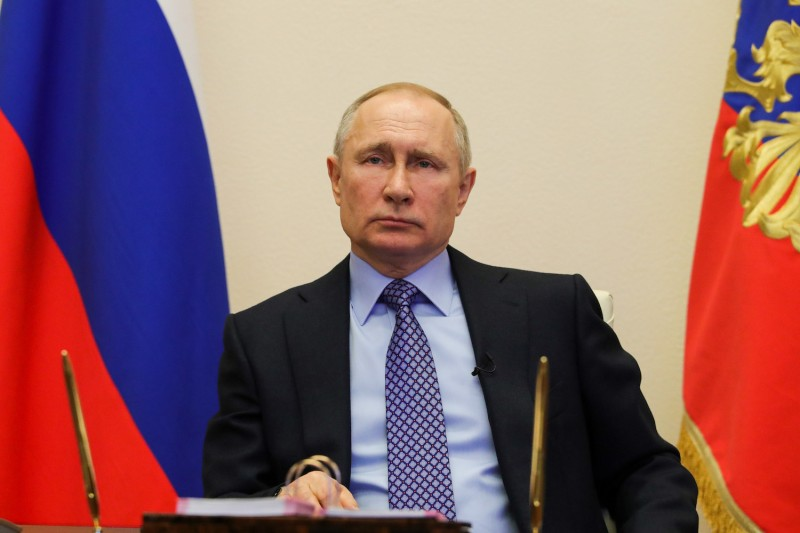 Russian President Vladimir Putin attends a virtual meeting with regional officials.