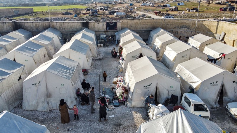 Syrians displaced by the war gather in Idlib