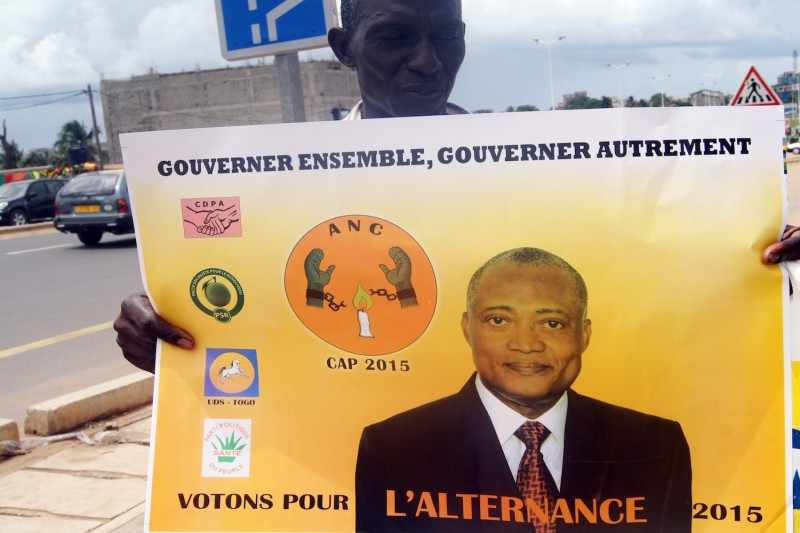 A man holds a poster displaying Togolese opposition leader Jean-Pierre Fabre on April 11, 2015 in Lome, Togo.