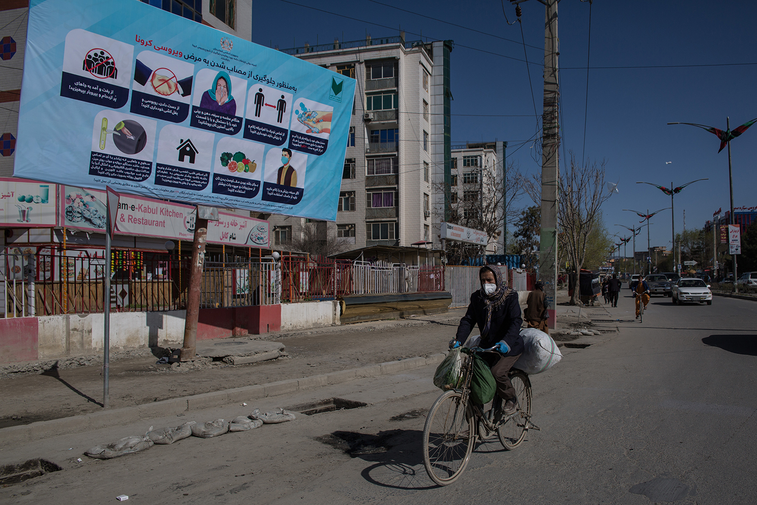 A sign warns of the symptoms of the coronavirus and explains measures that need to be taken to prevent an infection in central Kabul on April 2.