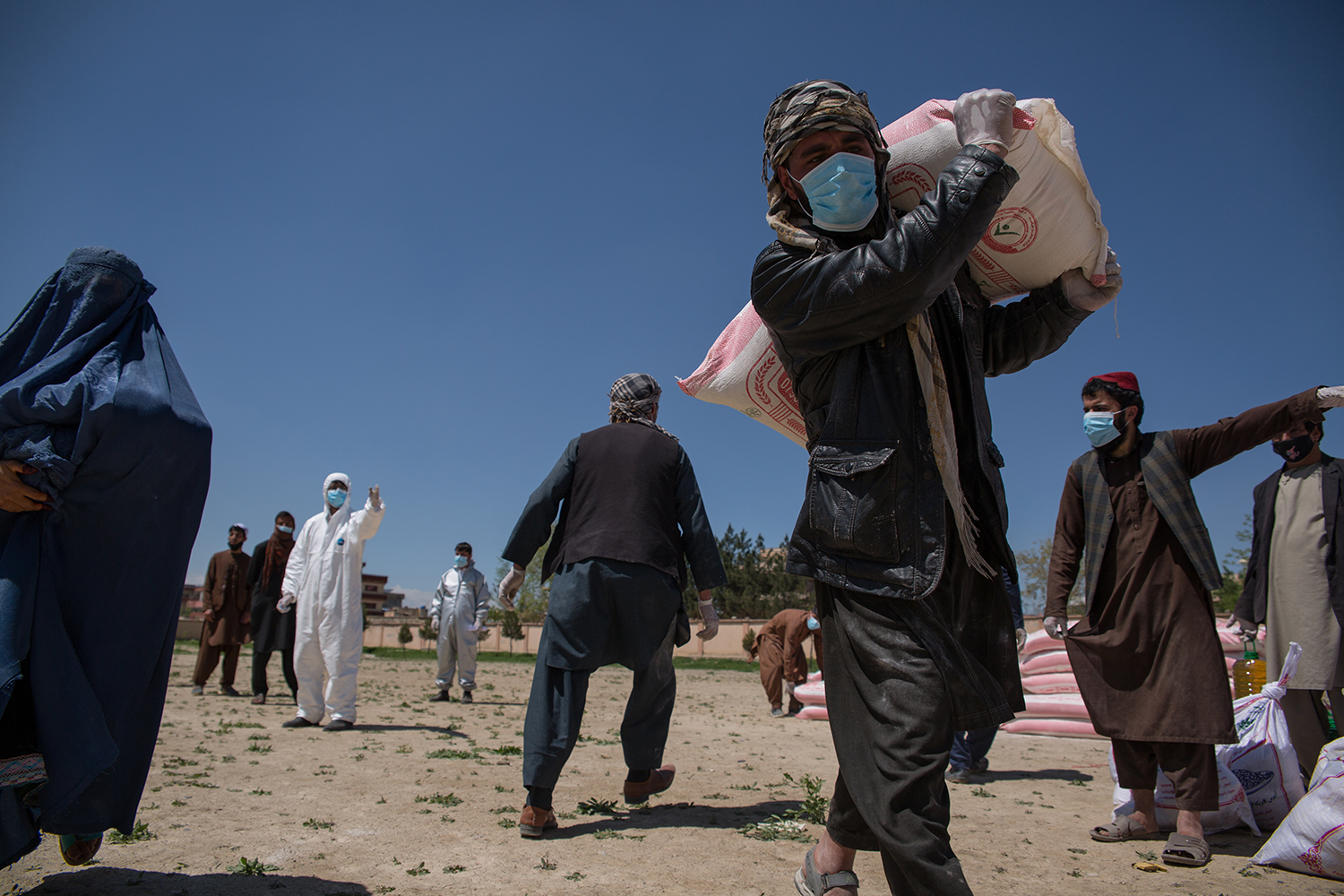 Food is distributed by the Relief and Emergency Fund Afghanistan, an initiative that is mostly privately funded by the U.S.-based Afghan diaspora, in Kabul on April 23.