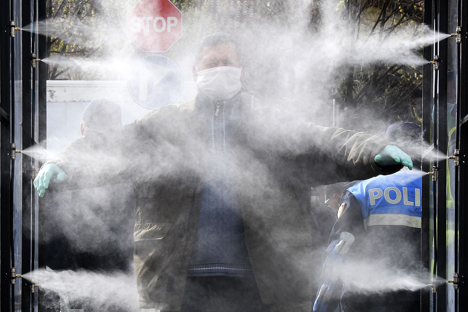 A man gets disinfected prior to going to a market in Tirana, Albania, on April 6. GENT SHKULLAKU/AFP via Getty Images