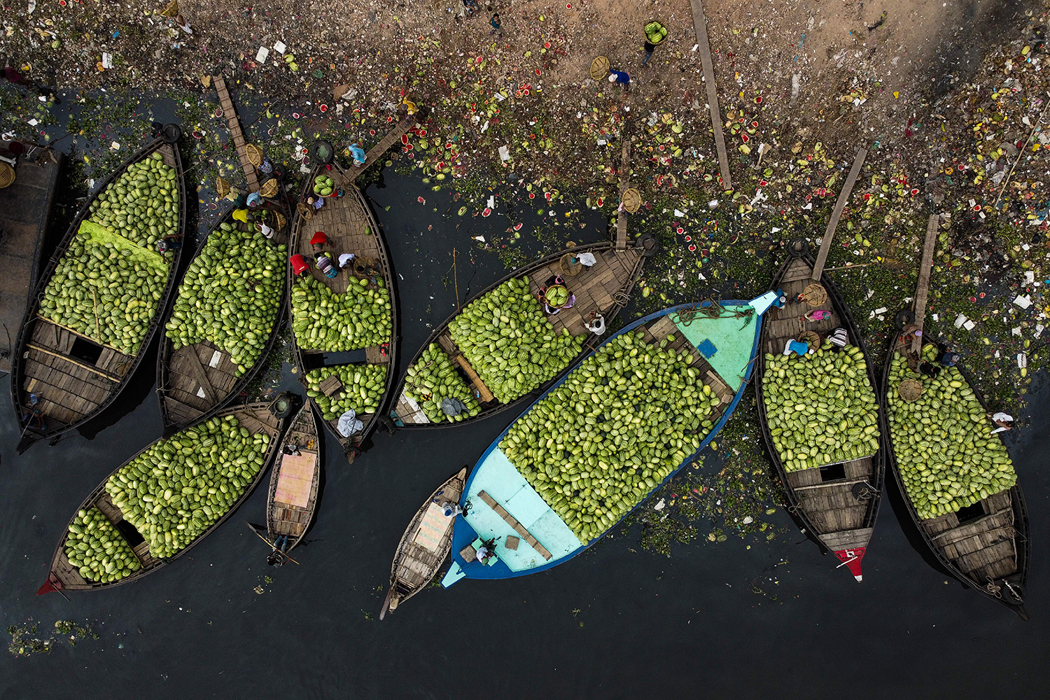 Workers load watermelons into boats in the Buriganga River in Dhaka, Bangladesh, on April 17. MUNIR UZ ZAMAN/AFP via Getty Images