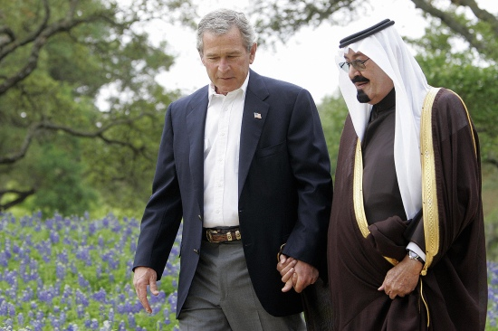 U.S. President George W. Bush holds hands with Saudi Crown Prince Abdullah as they walk at Bush's ranch in Crawford, Texas, on April 25, 2005.