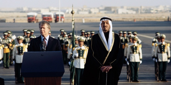 King Khalid of Saudi Arabia stands with U.S. President Jimmy Carter during a ceremony welcoming the American president to Riyadh in January 1978.