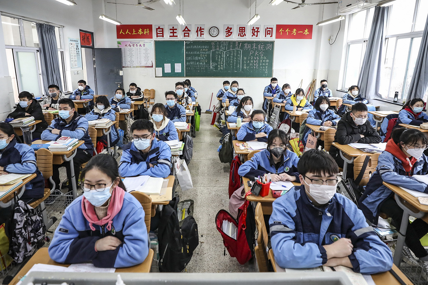 Students return to the classroom in Huai'an, China, on March 30 following the coronavirus outbreak. STR/AFP via Getty Images