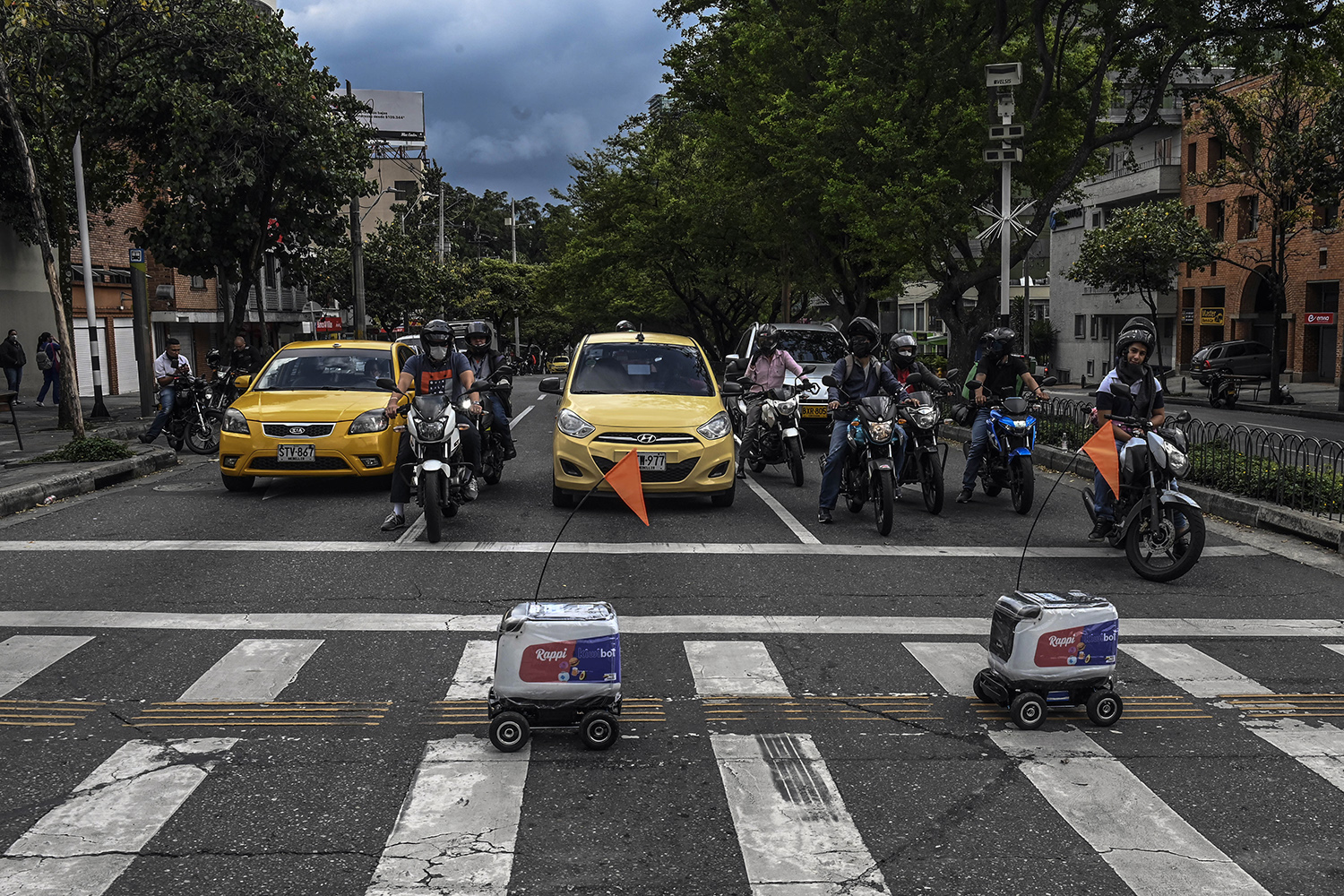 Two robots cross a street in Medellin, Colombia, on April 22 in order to deliver food to people staying at home during the lockdown. JOAQUIN SARMIENTO/AFP via Getty Images