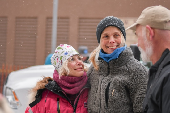 Veteran musher Dee Dee Jonrowe (left), stands alongside rookie competitor and mentee Mille Porsild of Denmark on March 7.