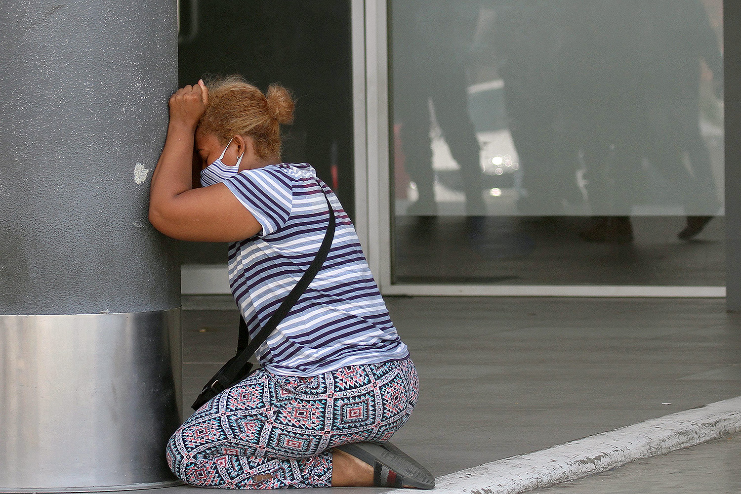 A woman cries after learning about the death of a relative at Los Ceibos Hospital in Guayaquil, Ecuador, on April 4. ENRIQUE ORTIZ/AFP via Getty Images
