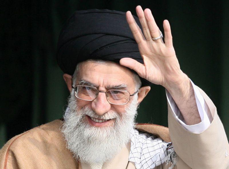 Iran's supreme leader, Ayatollah Ali Khamenei, waves as he attends a gathering of Basij militia forces in Tehran on Nov. 26, 2007.