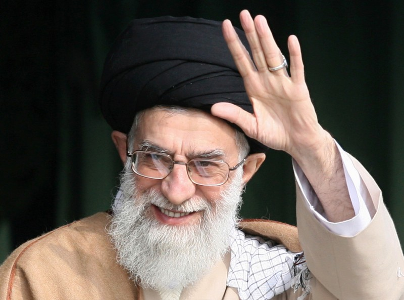 Iran's supreme leader, Ayatollah Ali Khamenei, waves as he attends a gathering of Basij militia forces in Tehran on Nov. 26, 2007.
