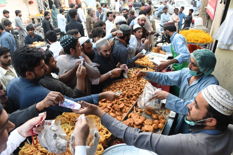 Muslims buy food before breaking their Ramadan fast in Quetta, Pakistan, on May 12, 2019.