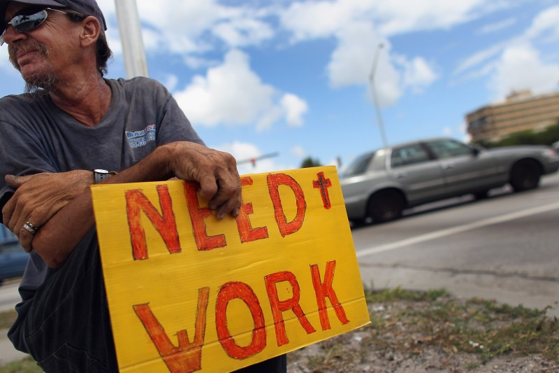 Stephen Greene works a street corner hoping to land a job as a laborer or carpenter in Pompano Beach, Florida, on June 3, 2011.