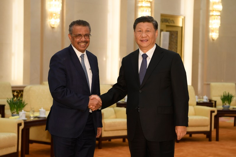 Tedros Adhanom Ghebreyesus (left), the director-general of the World Health Organization, shakes hands with Chinese President Xi Jinping before a meeting at the Great Hall of the People in Beijing on Jan. 28.