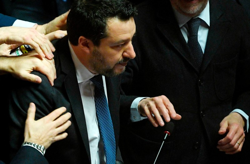 Fellow members of his party congratulate Italian  far-right League leader Matteo Salvini after he addressed the Senate in Rome on Feb. 12.