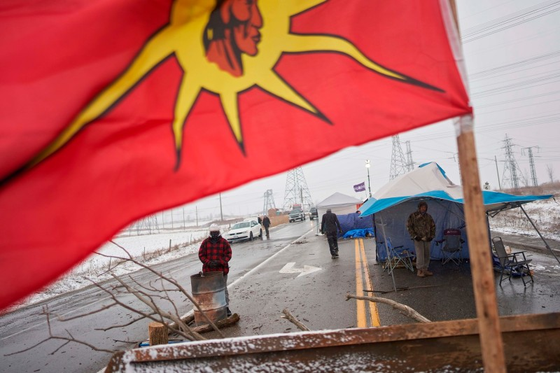 Protesters man a barricade in support of the Wet'suwet'en hereditary chiefs and the Tyendinaga Mohawks