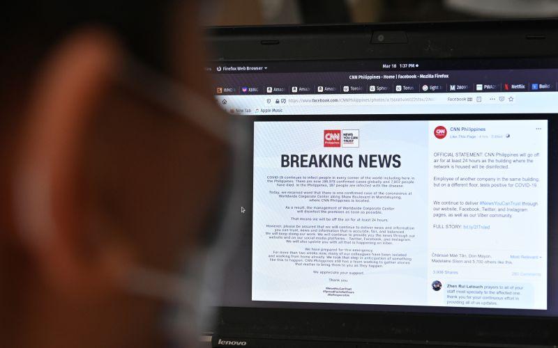 A man reads a coronavirus news alert