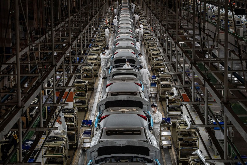 Workers assemble cars at the Dongfeng Honda plant in Wuhan, China, after returning to work following a months-long lockdown, on March 23, 2020.