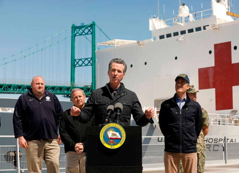 California Governor Gavin Newsom speaks in front of the hospital ship USNS Mercy after it arrived into the Port of Los Angeles on March 27, 2020.