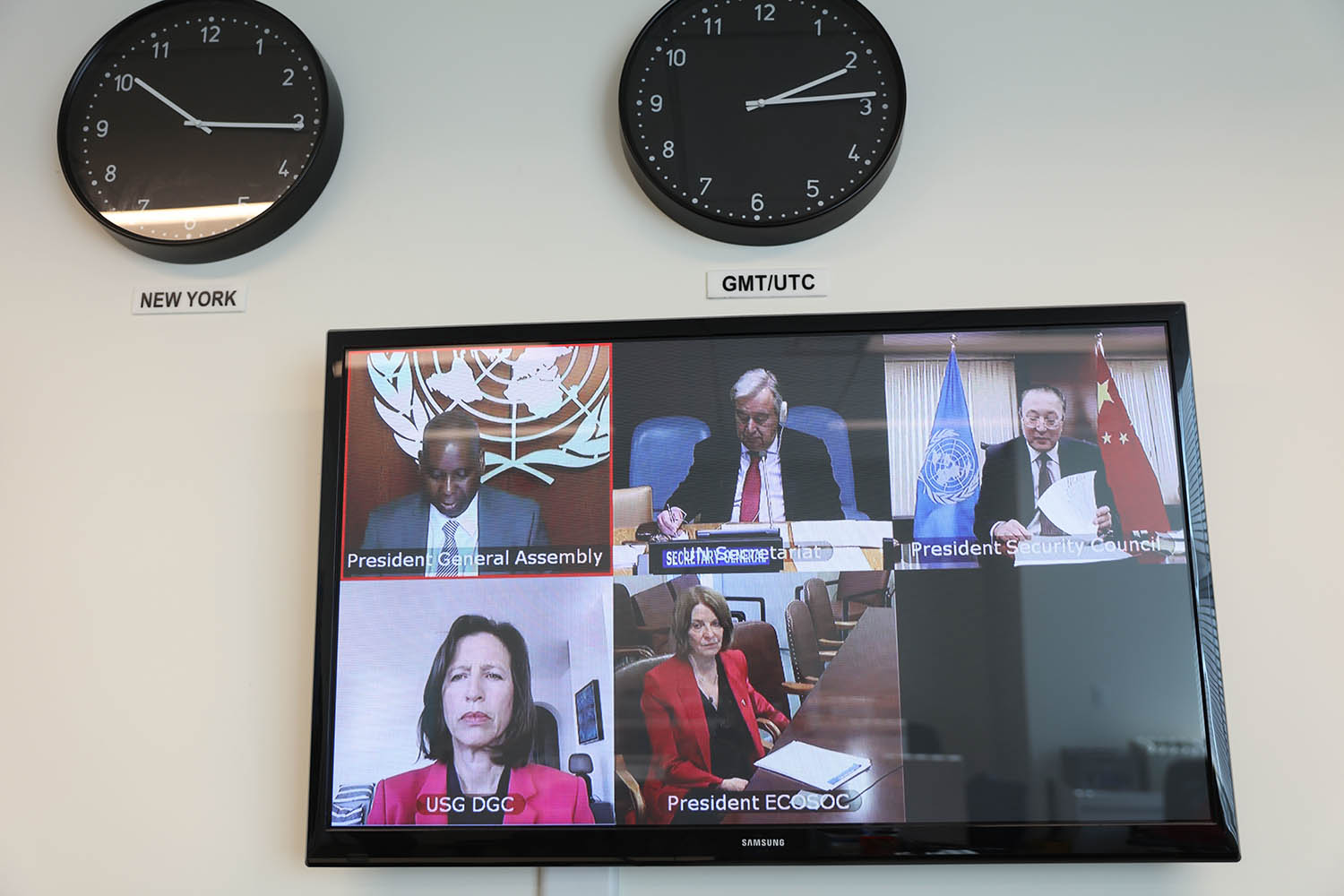 A screen at the U.N. headquarters in New York shows a virtual joint briefing by the U.N. principal organs to member states on the COVID-19 response on March 27.