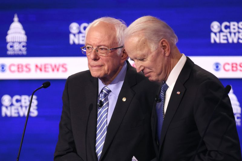 Joe Biden and Bernie Sanders on a debate stage in Charleston, South Carolina.
