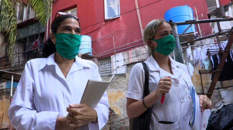 Cuban health workers go door to door looking for possible cases of the novel coronavirus in Havana on March 31.