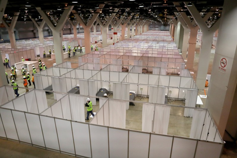 Construction workers put the finishing touches on Hall C Unit 1 of the COVID-19 alternate site at McCormick Place in Chicago on Friday, April 3, 2020.  Hall C will house 500 beds.  (Chris Sweda/Chicago Tribune)