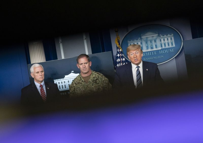 U.S. President Donald Trump speaks alongside Vice President Mike Pence and Navy Rear Adm. John Polowczyk during a press briefing in Washington, DC, on April 5.
