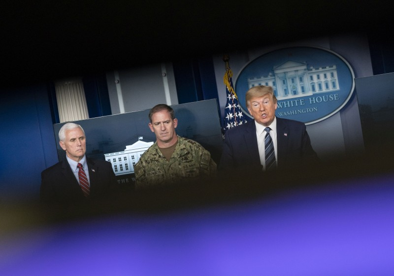 U.S. President Donald Trump (right) speaks alongside Vice President Mike Pence (left) and Navy Rear Adm. John Polowczyk during a press briefing in Washington on April 5.