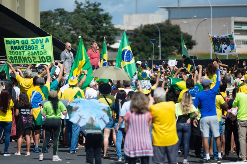 President Jair Bolsonaro speaks with supporters in Brasília on April 19.