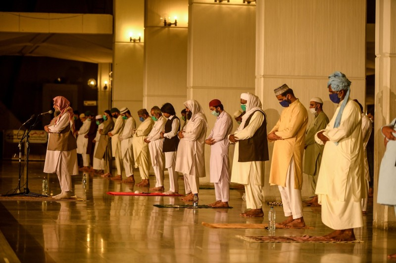 Muslims maintain social distancing as they offer a special Taraweeh evening prayer ahead of the first day of the holy month of Ramadan at the Grand Faisal Mosque in Islamabad on April 24.