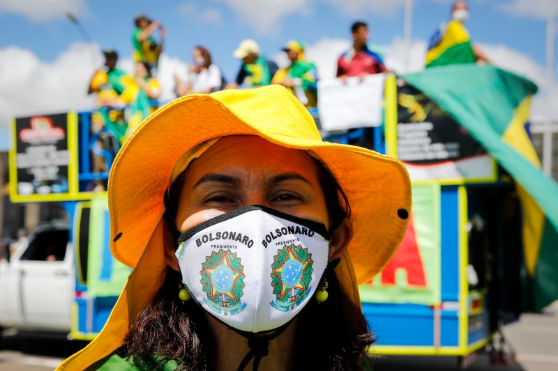 A supporter of Brazilian President Jair Bolsonaro demonstrates during a motorcade against the quarantine and social distance measures in Brasilia on April 26, 2020.