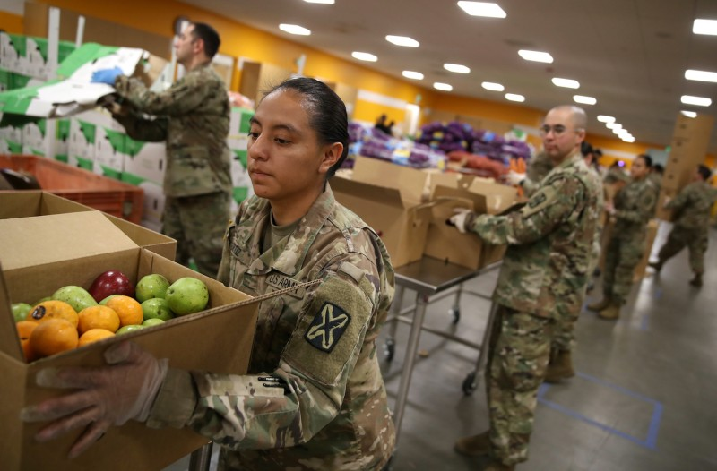 Members of the California National Guard help pack boxes on March 24 in San Jose, California.