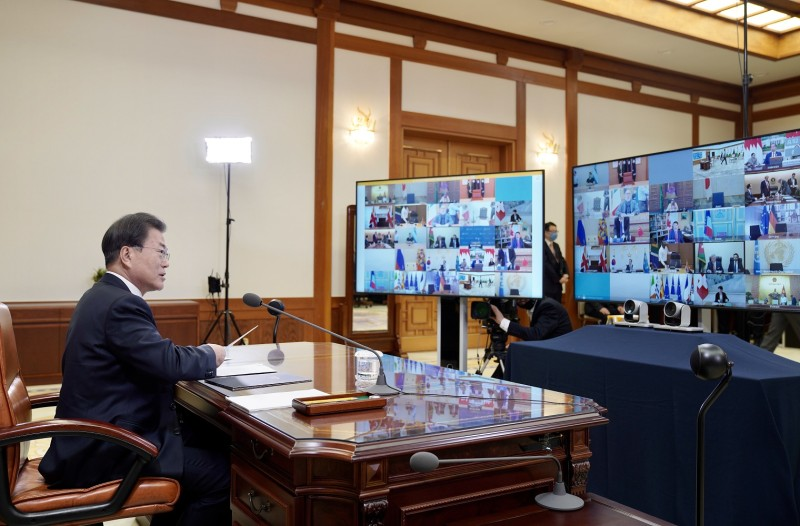 South Korean President Moon Jae-in discusses a coronavirus response with global leaders and shares South Korea's strategy during a virtual summit in Seoul on March 26.