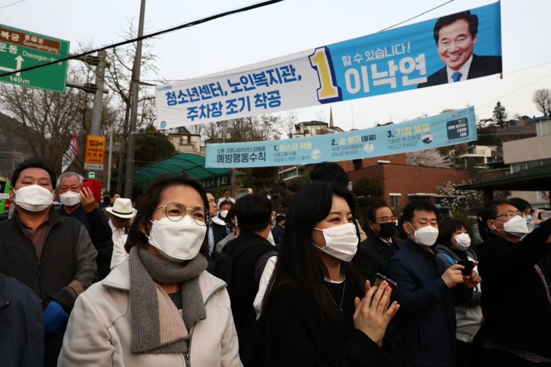 Supporters of South Korea's ruling Democratic Party listen to a speech during the recent election campaign as citizens take measures to protect themselves against the spread of the coronavirus in Seoul on April 10.