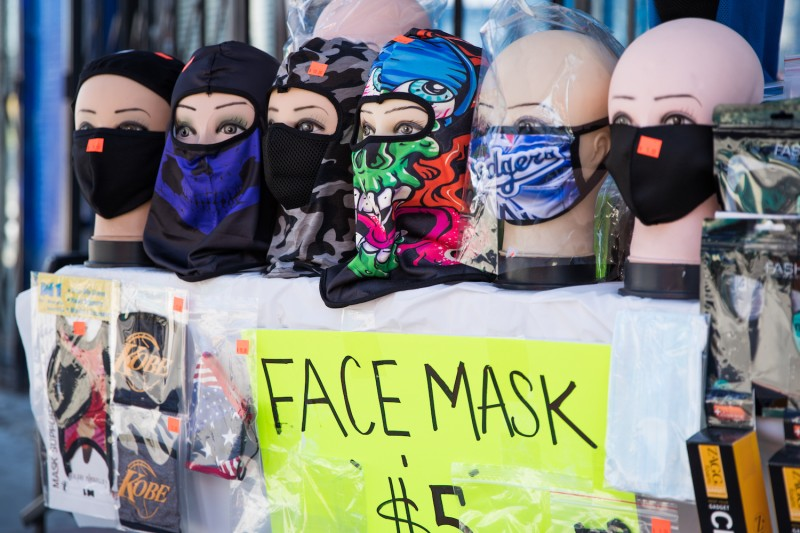 A street vendor sells face masks from a pop up stand on April 15, 2020 in Los Angeles, California.