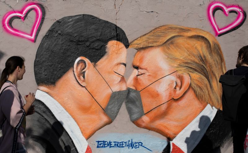 Graffiti showing U.S. President Donald Trump and Chinese President Xi Jinping in Berlin on April 26.