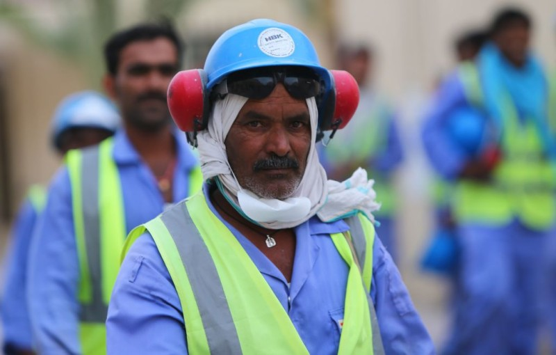 Foreign laborers working on a construction site for one of Qatar's 2022 World Cup stadiums
