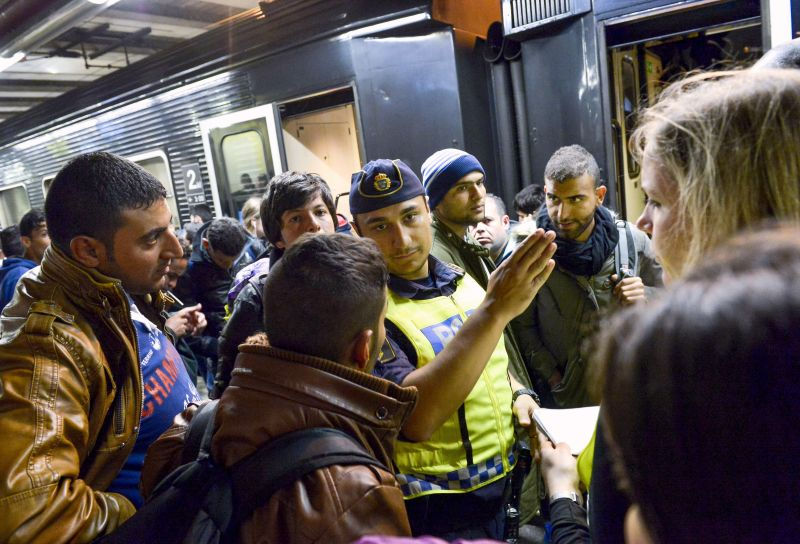 A police officer gestures at the railway station in Stockholm on Sept. 12, 2015.