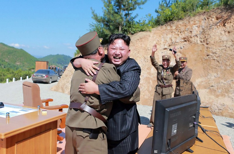 This picture, taken on July 4, 2017, and released by North Korea's official Korean Central News Agency, shows North Korean leader Kim Jong Un (center) celebrating the successful test fire of the intercontinental ballistic missile Hwasong-14 at an undisclosed location.