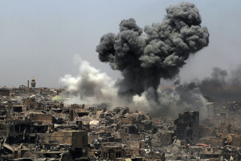 Smoke billows following an airstrike by the US-led international coalition forces targeting Islamic State (IS) group in Mosul, Iraq, on July 9, 2017.