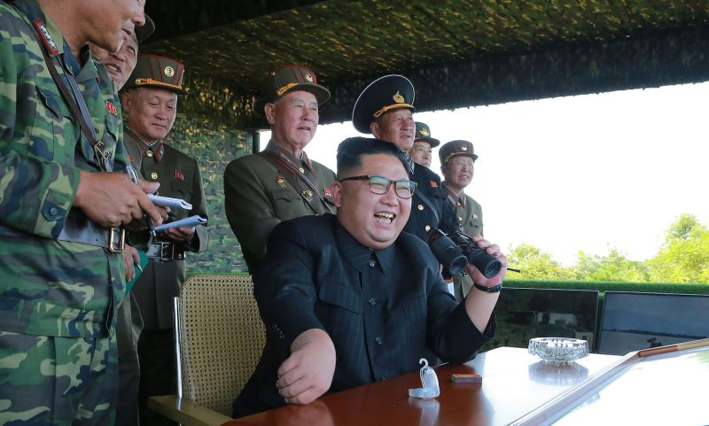 North Korean leader Kim Jong Un (center) presides over a target strike exercise conducted by the special operation forces of the Korean People's Army at an undisclosed location in an undated photo.