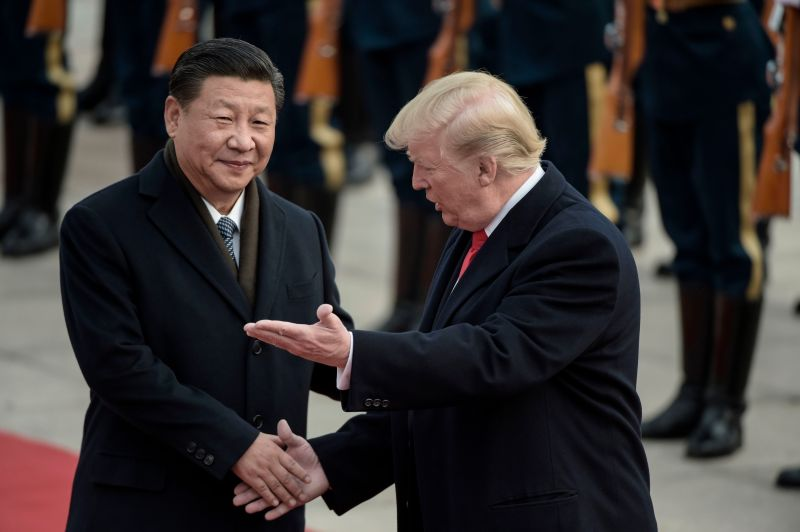 China's President Xi Jinping (L) and US President Donald Trump attend a welcome ceremony at the Great Hall of the People in Beijing on November 9, 2017.