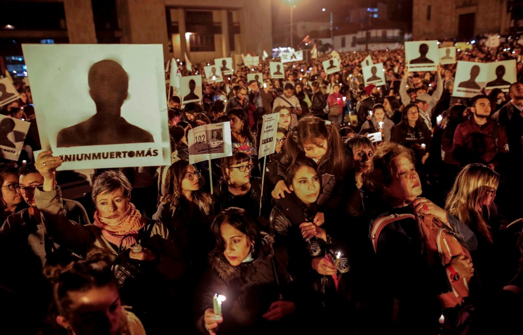 Protesters at a vigil for murdered social leaders in Bogotá, Colombia, on July 6, 2018.