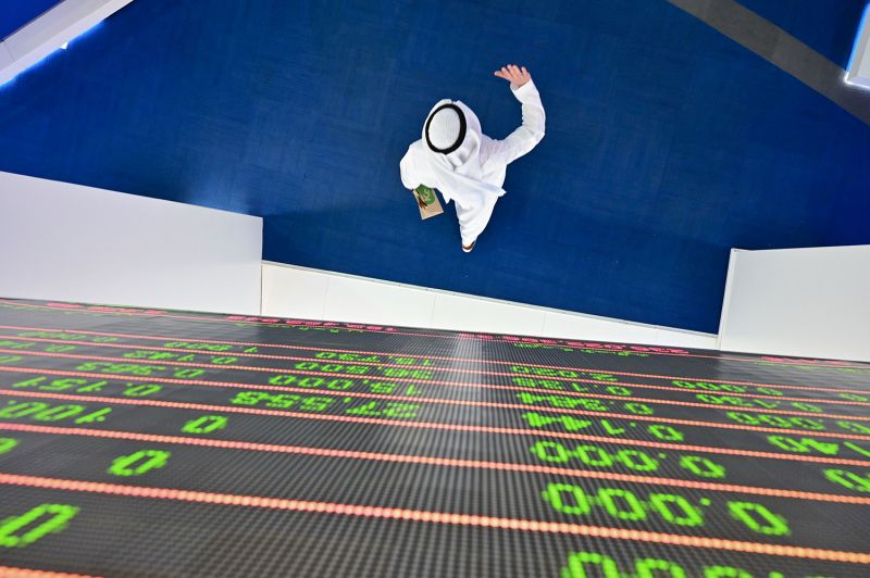 A trader at the Dubai Stock Exchange in the United Arab Emirates.
