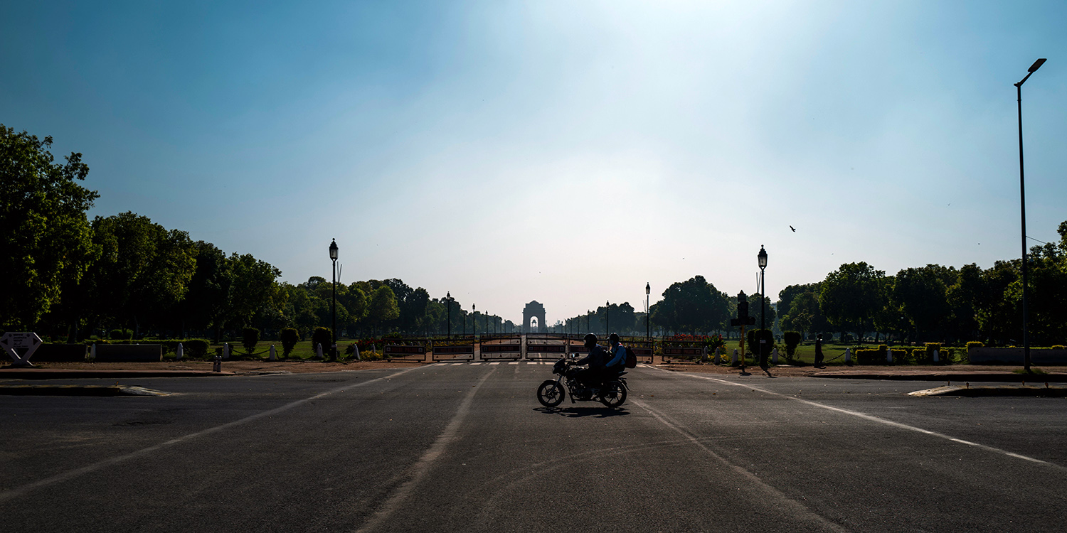 A motorist rides April 2 along a deserted street in New Delhi, which is regularly listed as one of the world's most polluted cities but has seen periods of clean air as a result of the coronavirus lockdown.