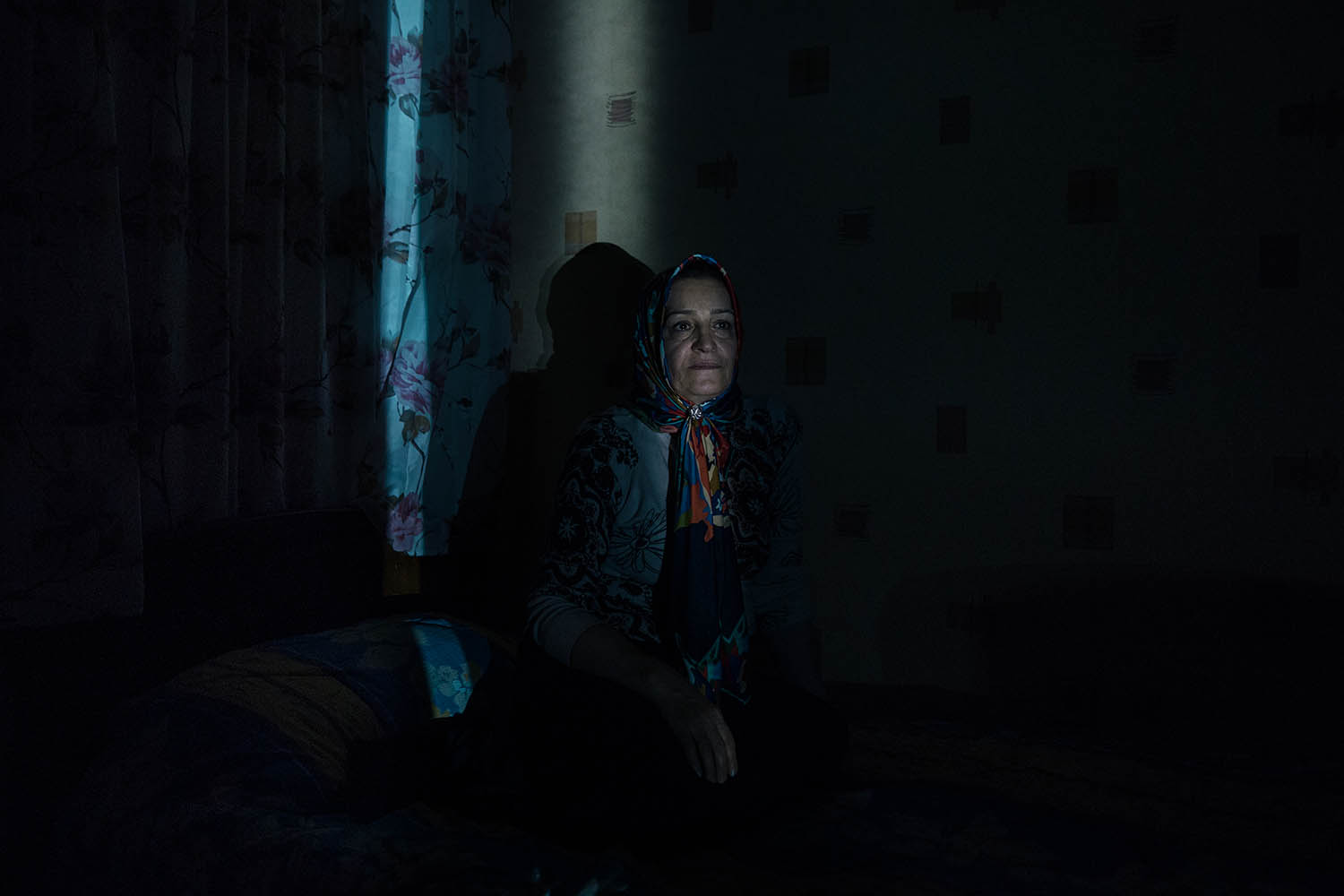 Akram sits in her son's room in Tehran on Dec. 12, 2018.