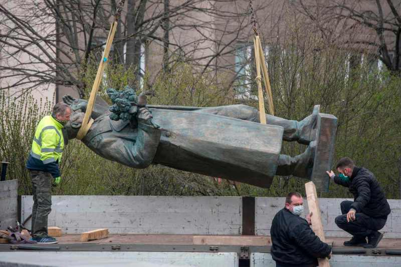 Workers load a statue of the controversial Soviet army marshal Ivan Konev onto a truck after it was removed from a Prague park on April 3.