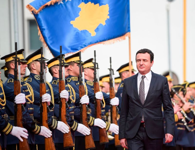 Newly elected Prime Minister Albin Kurti reviews Kosovo's honor guard during the handover ceremony in Pristina on Feb. 4.